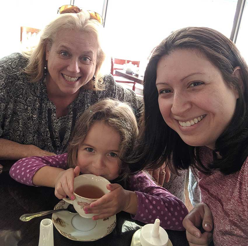 Danielle Austen and her stepmother enjoy a tea party with Austen's daughter, Fariah.